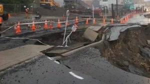 Footpath collapses into monster urban slip